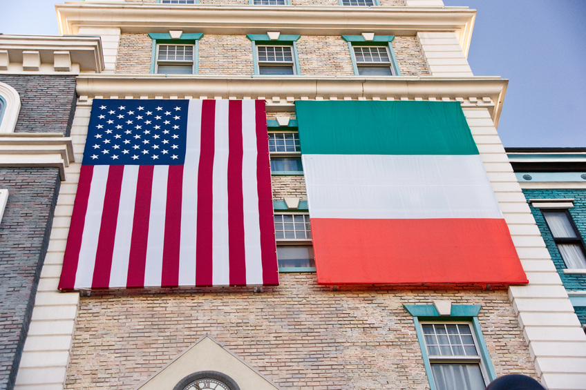 Large Irish and American flags hang on a New York, New York building facade, ready for St. Patrick's Day.