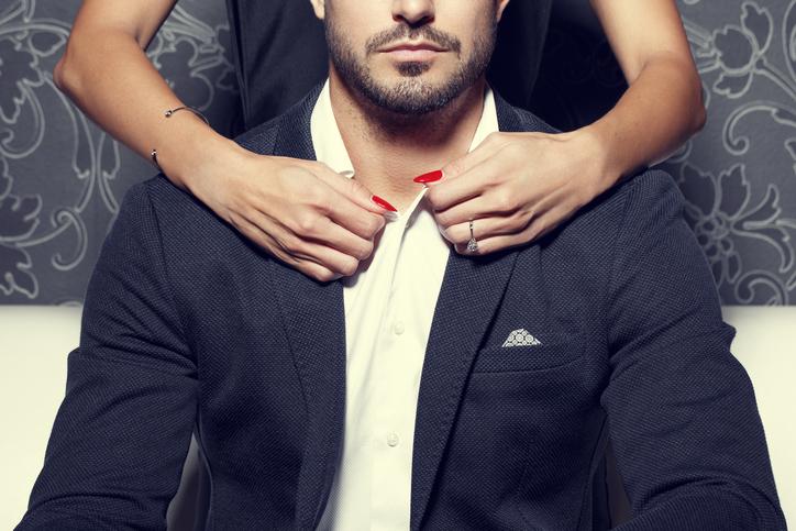 Woman hands undress rich man, concept