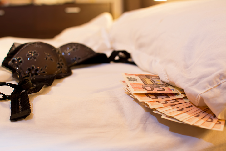 Underware, bed and money to symbolize the cost of sex.