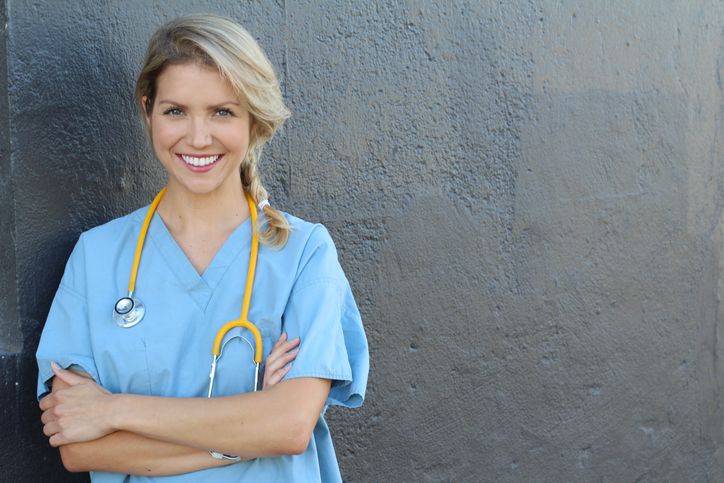 Young beautiful successful female doctor with stethoscope - portrait with copy space.