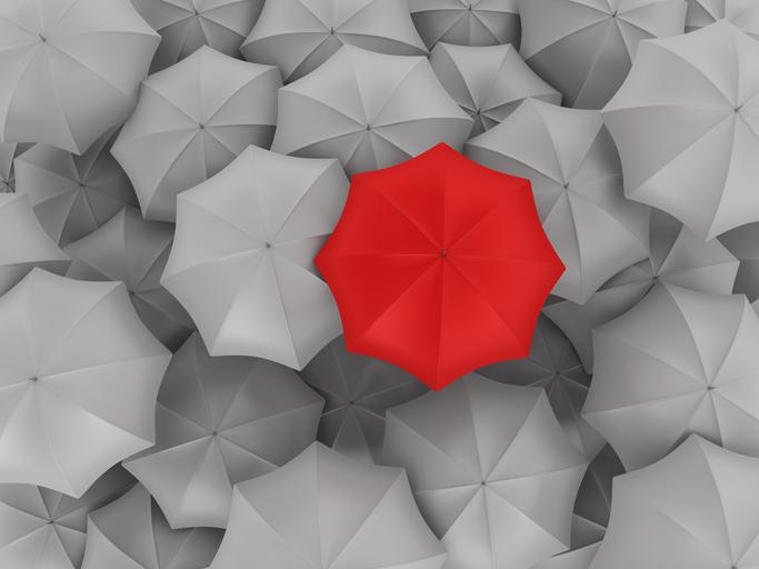 A red umbrella in a sea of grey