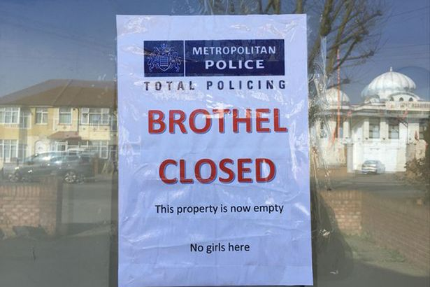 Funny sign saying brothel is closed