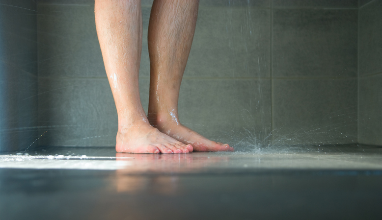 Closeup of wet legs in the bathroom.