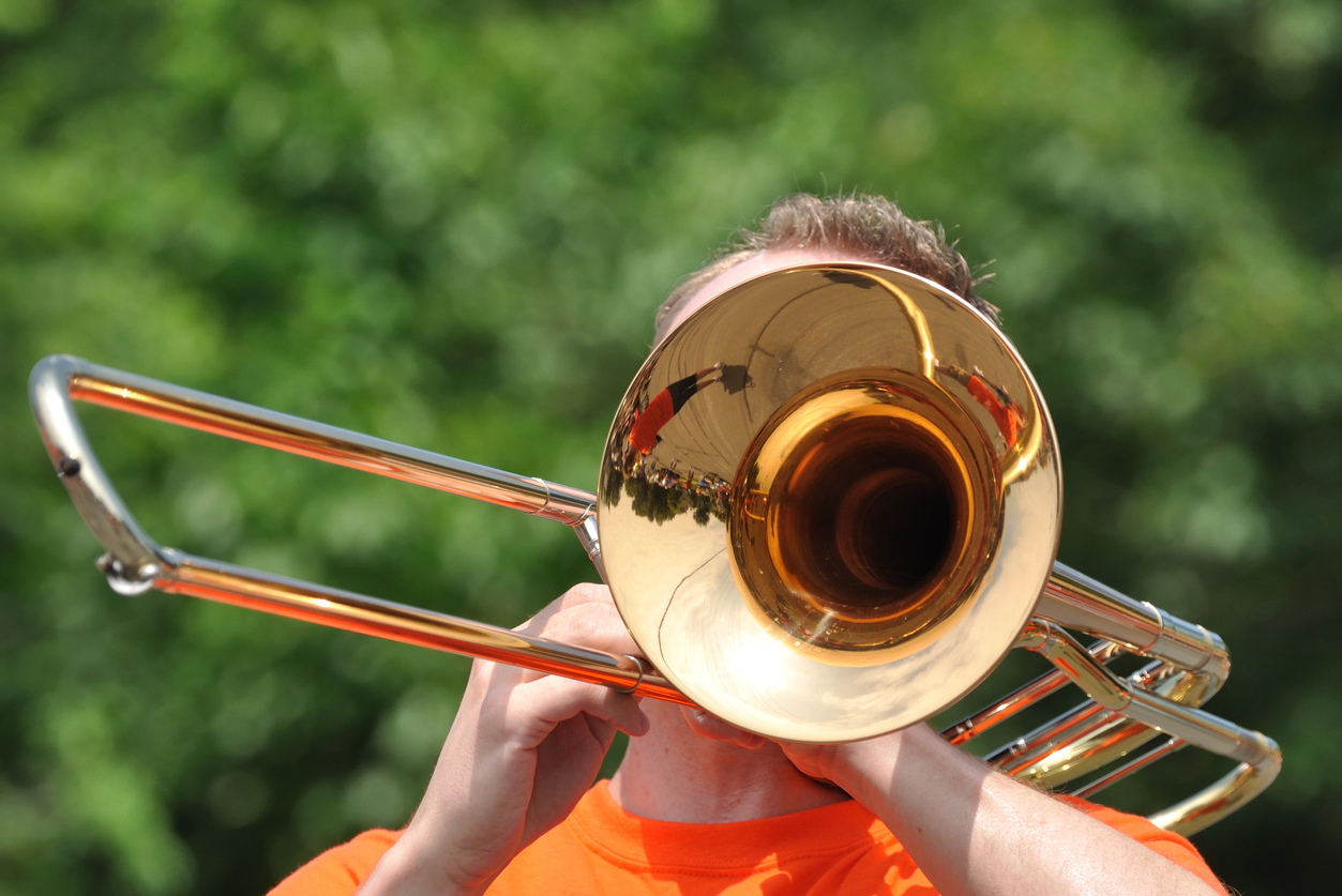 Marching Band Performers Playing Trombones in Parade, Copy Space