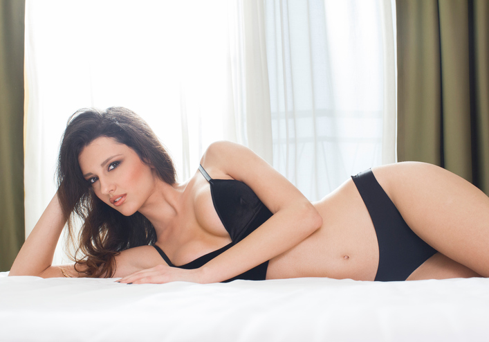 Beautiful woman lying in bed
