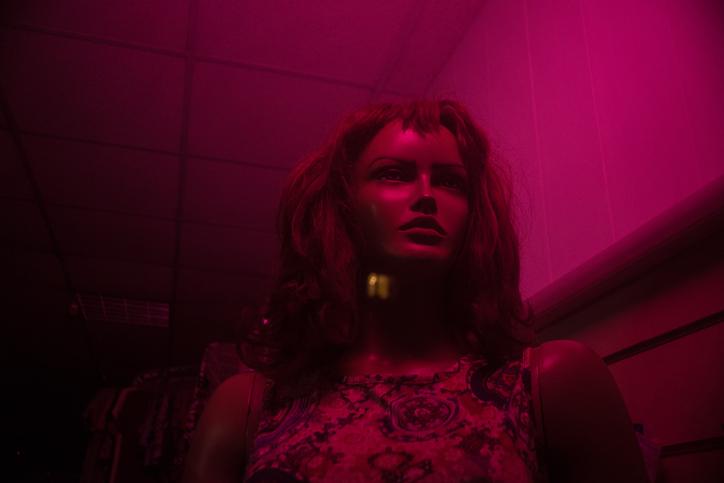 Dummy woman portrait in a pink neon light