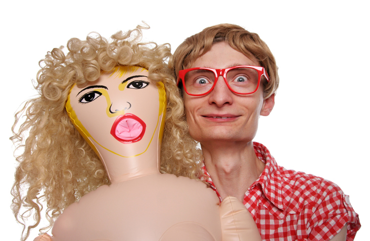 a man with a blow up doll