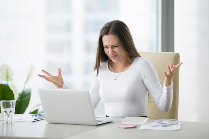 socked woman looking at laptop