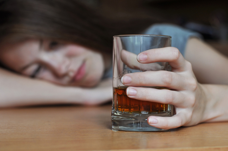Drunk female with whiskey