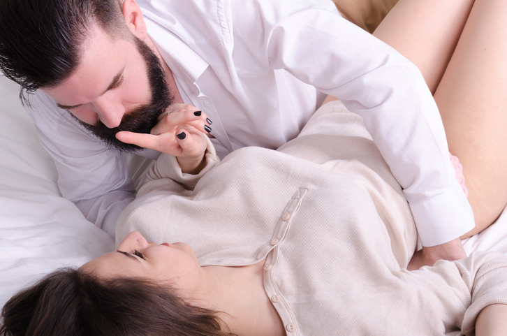 Woman tells man to be quiet in bed