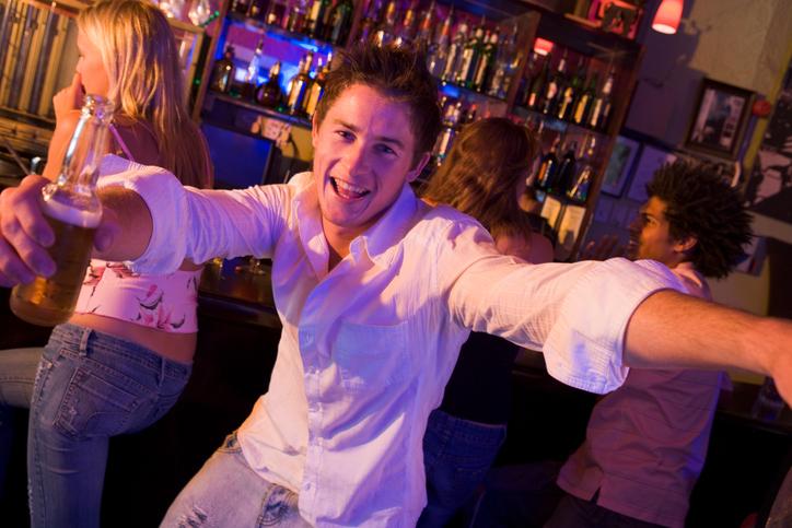 Young drunk man in nightclub