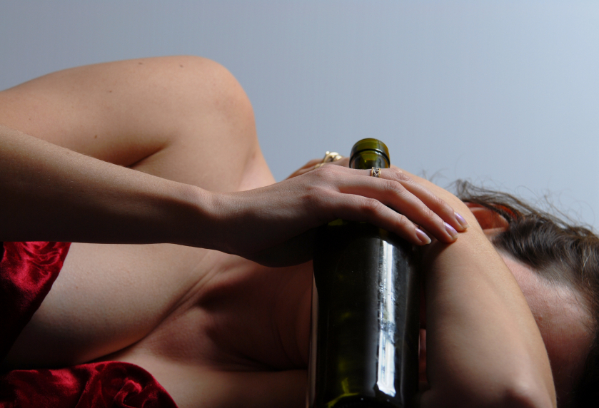 Scantily clad woman passed out with bottle