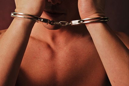 Man wearing handcuffs in front of him