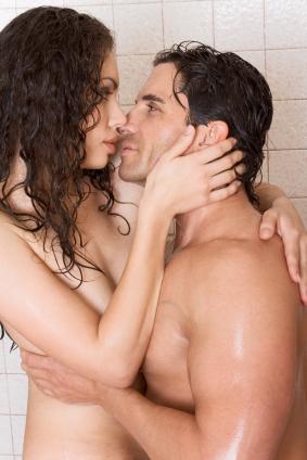 A naked couple kiss