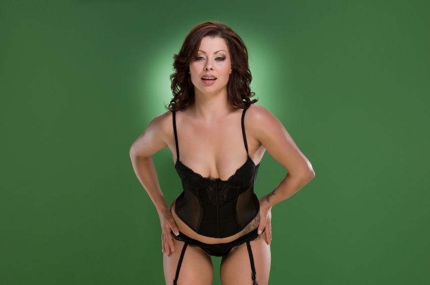 A woman standing in lingerie on a green background, representing sexy Ireland