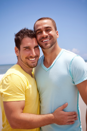 Two fully clothed gay men holding each other