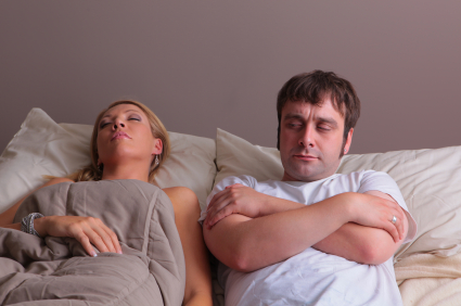 couple in bed, man without cover, woman is sleeping, HQlypse