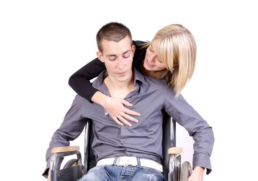 young woman taking care of a young man in a wheelchair.