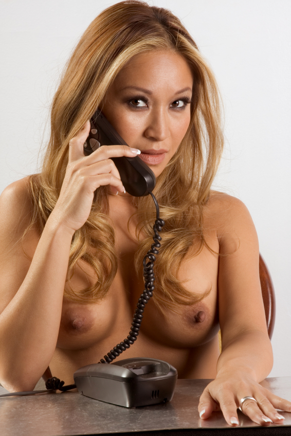 Topless woman on phone