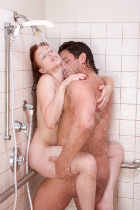 Man holds woman against wall in the shower