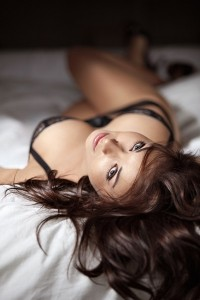 Sexy brunette lying in lingerie in bed