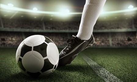 Foot kicks ball