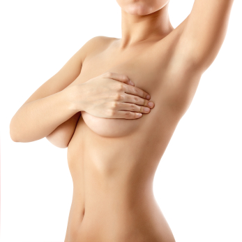 Naked woman covering up her breasts