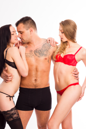 Guy and two women in a threesome