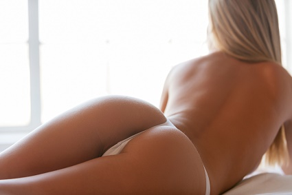 Beautiful buttocks. Close-up of perfect buttocks of the beauty lying in bed
