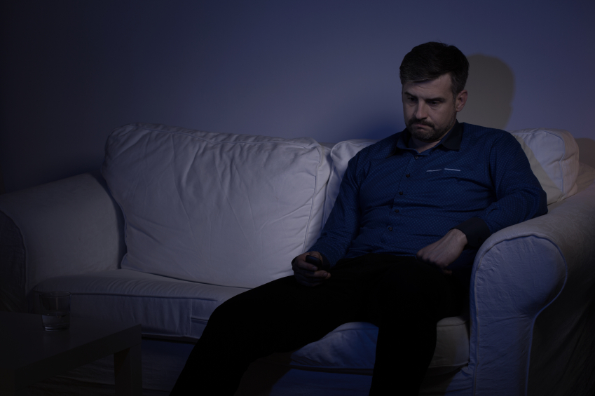 Depressed man on couch