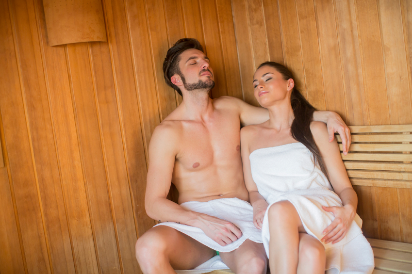 Towelled man and woman in sauna