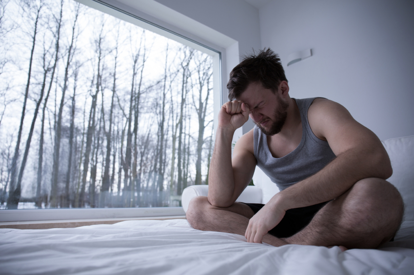 Man in pain on bed
