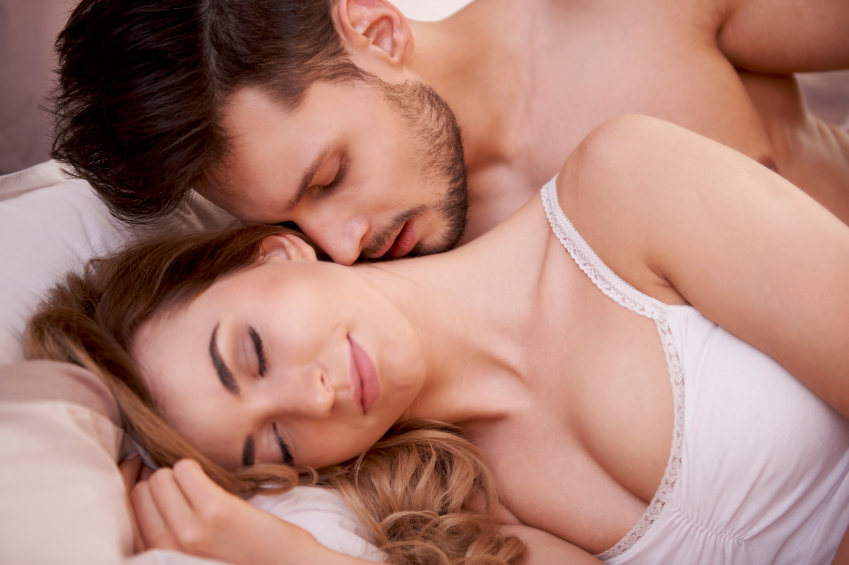 Man kisses neck of sleeping woman