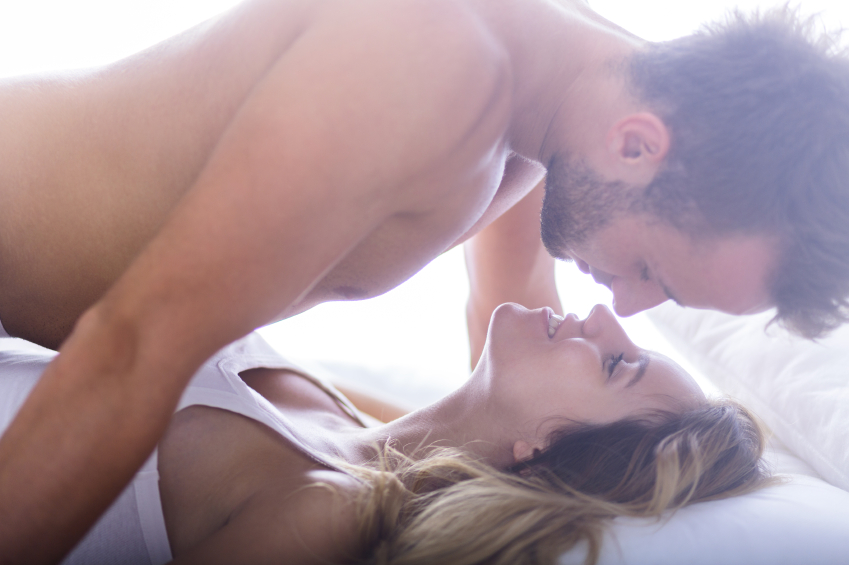 Man on top of woman having morning sex