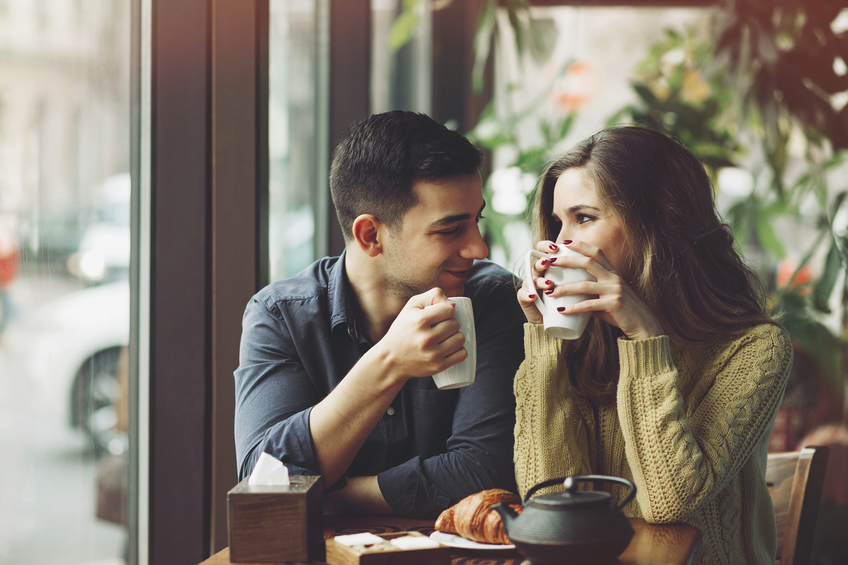 Happy couple in coffee shop